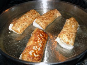 Egg Rolls Frying Golden Brown